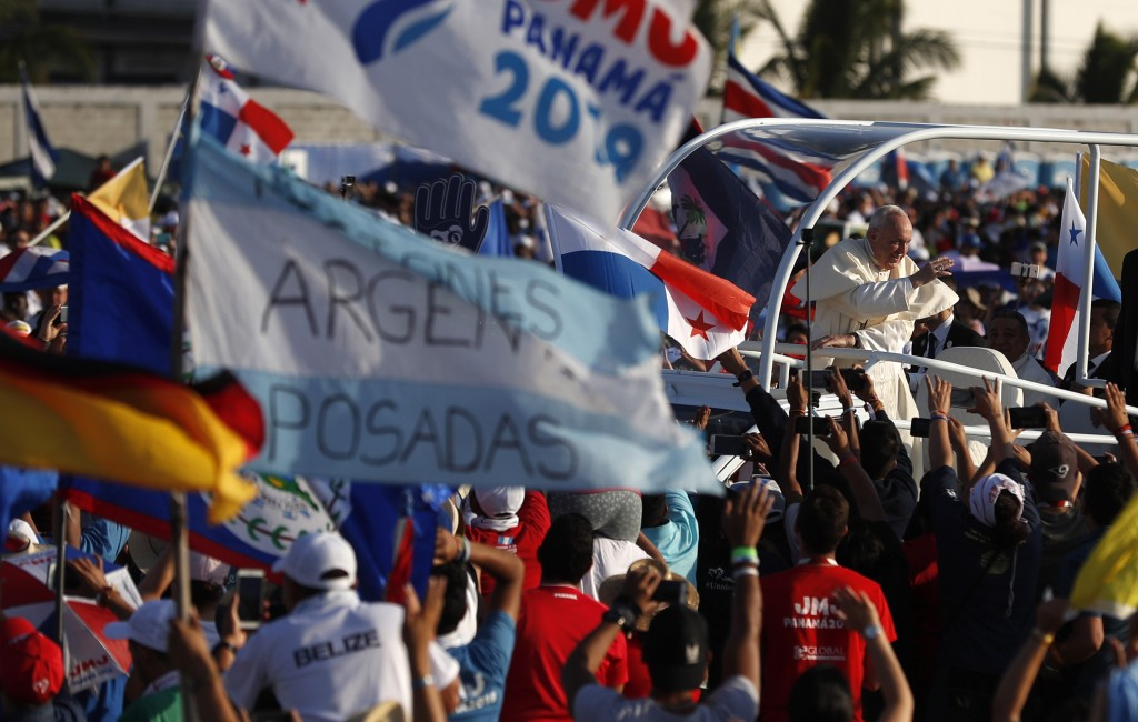 Youth greet Pope Francis as he arrives in his popemobile in the metro park Campo San Juan Pablo II, in Panama City, Sunday, Jan. 27, 2019, to celebrat