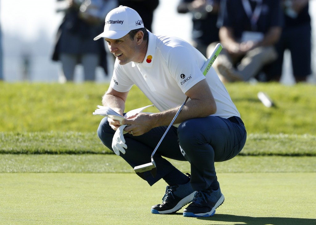Justin Rose of England looks over his line before putting on the first greeb of the South Course at Torrey Pines Golf Course during the third round