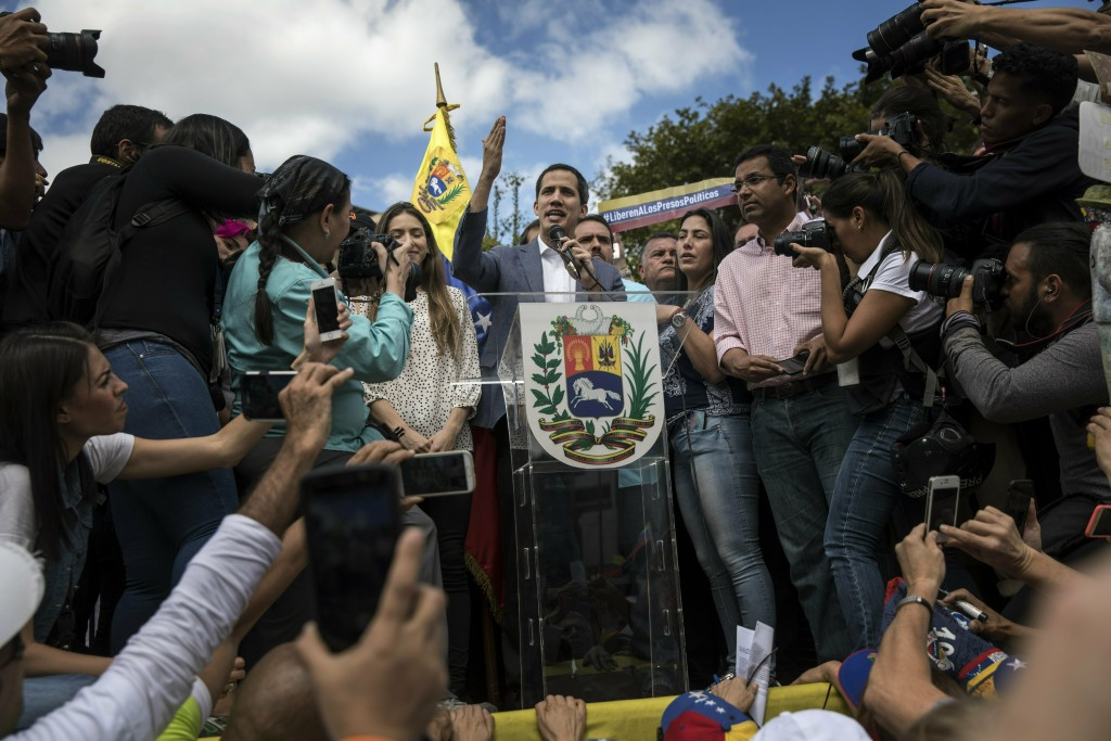 Venezuela's self-declared interim leader Juan Guaido speaks to supporters during a gathering to propose amnesty laws for police and military, at a pub...