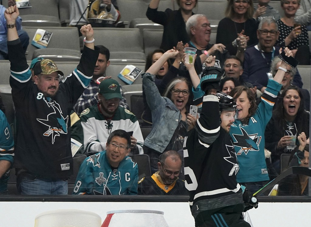 Pacific Division's Erik Karlsson, of the San Jose Sharks, celebrates after scoring a goal against the Central Division during the first half of a semi