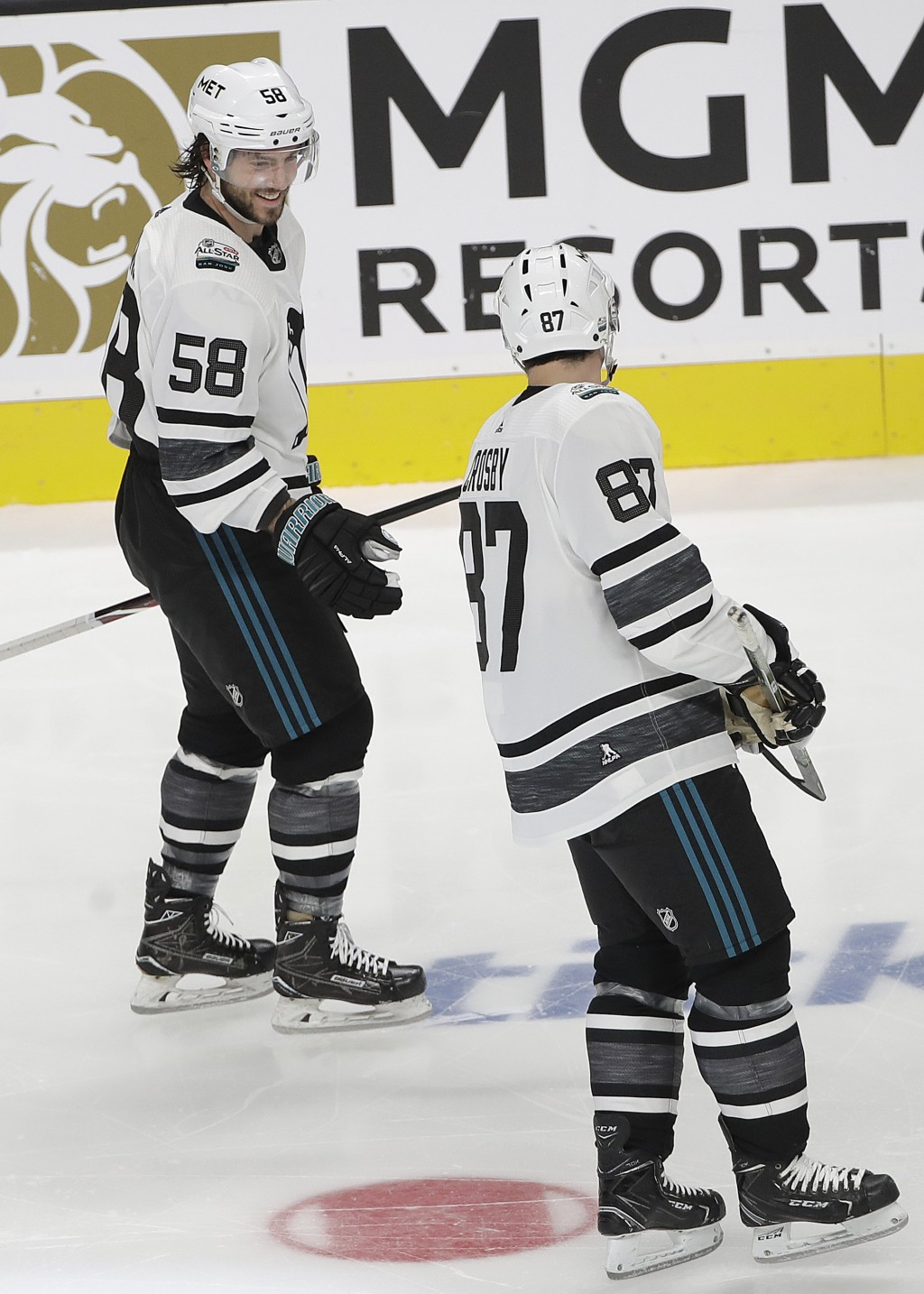 Metropolitan Division's Kris Letang, left, and Sidney Crosby, both of the Pittsburgh Penguins, celebrate after Letang scored against the Central Divis