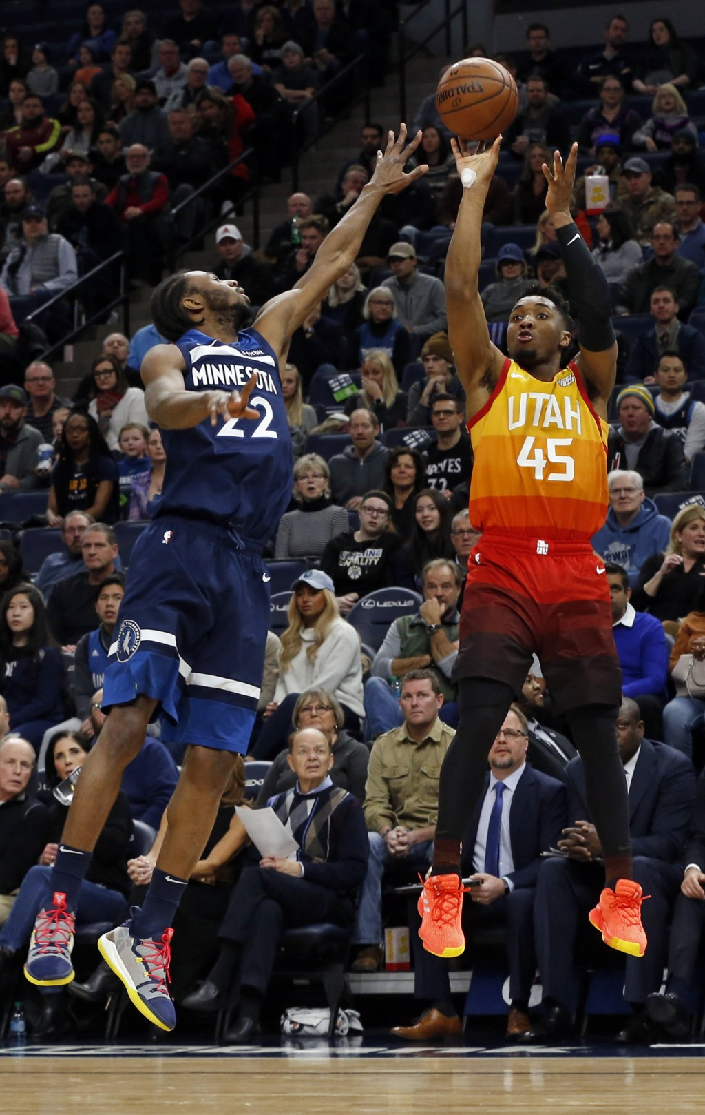 7057a04b Utah Jazz's Donovan Mitchell, right, shoots as Minnesota Timberwolves'  Andrew Wiggins defends in