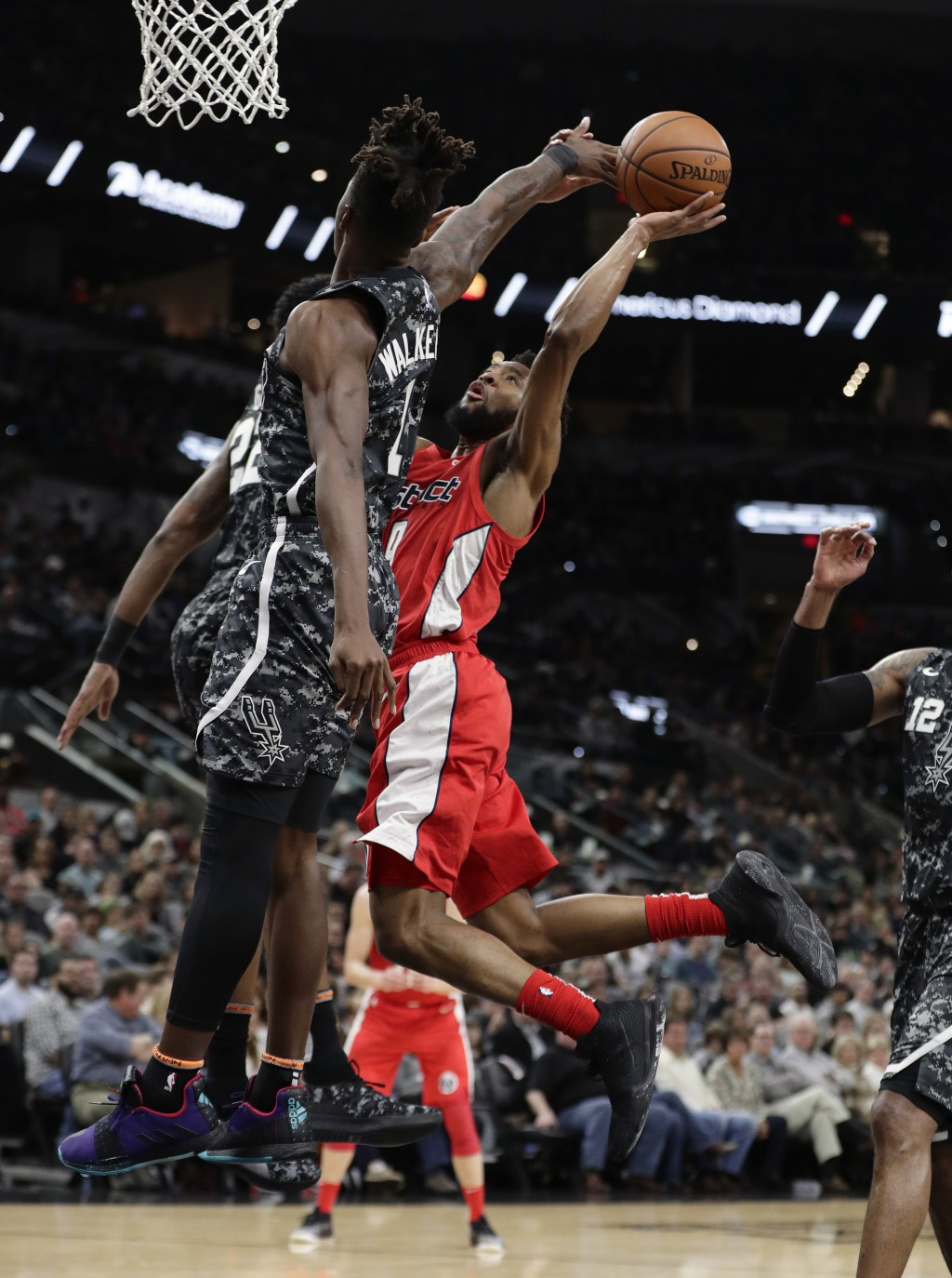 Washington Wizards guard Chasson Randle (9) drives to the basket against San Antonio Spurs guard Lonnie Walker IV (1) during the first half of an NBA ...