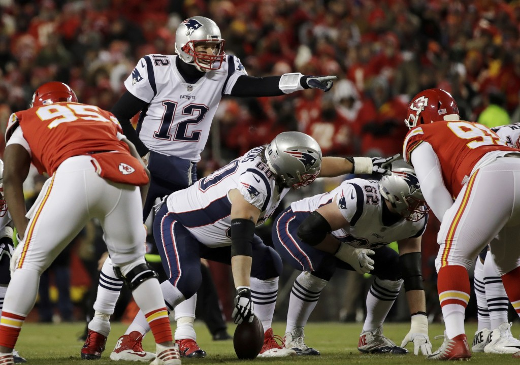 FILE- In this Jan. 20, 2019, file photo New England Patriots quarterback Tom Brady (12) calls a play during the first half of the AFC Championship NFL...