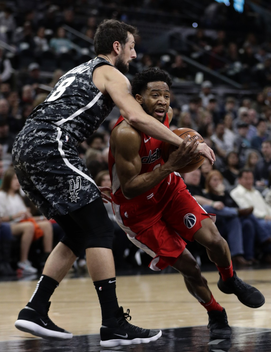 Washington Wizards guard Chasson Randle, right, is fouled as he drives around San Antonio Spurs guard Marco Belinelli, left, during the first half of ...