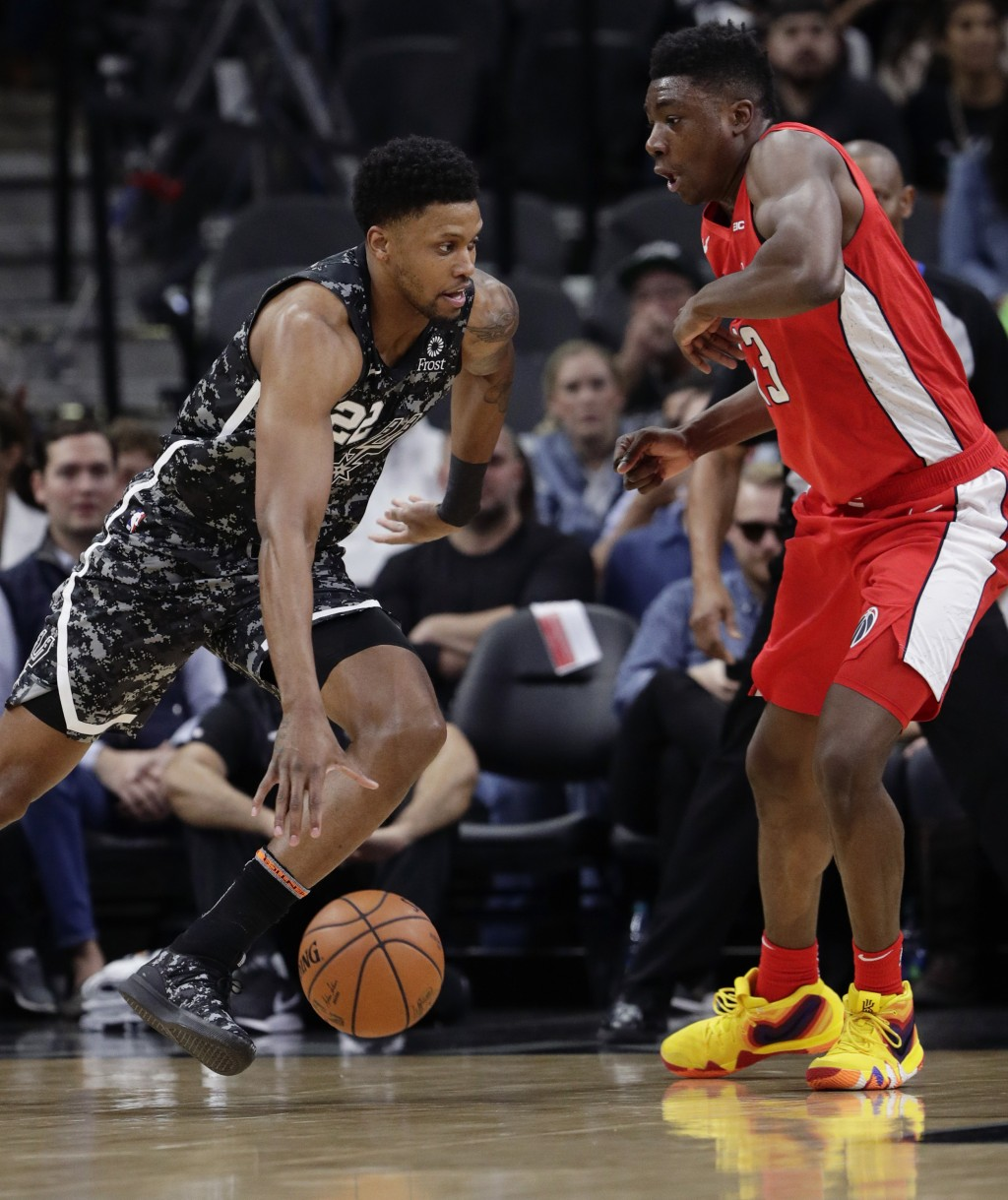 San Antonio Spurs forward Rudy Gay (22) drives around Washington Wizards center Thomas Bryant (13) during the first half of an NBA basketball game in ...