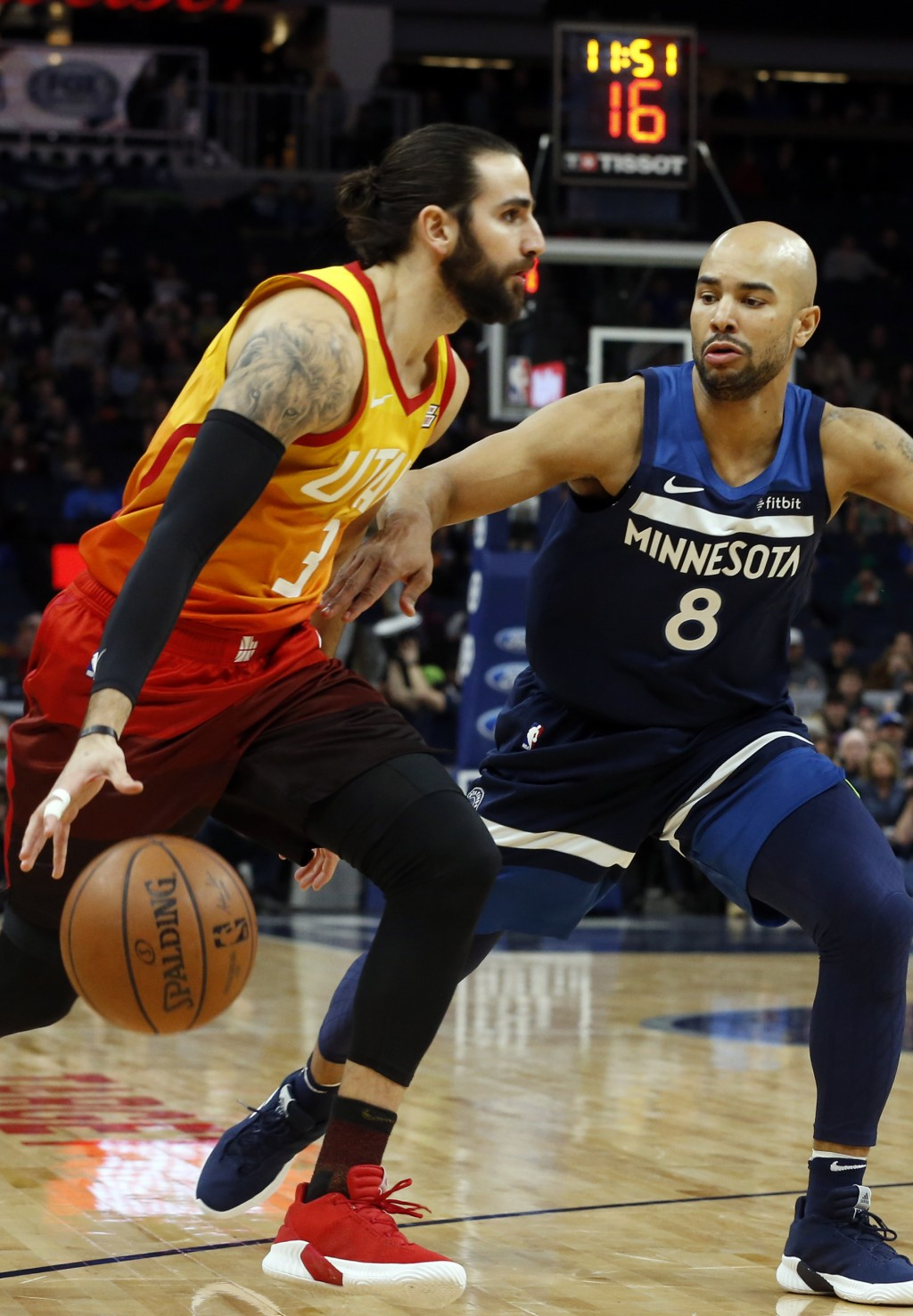 Utah Jazz's Ricky Rubio, left, of Spain, drives around Minnesota Timberwolves' Jerryd Bayless in the first half of an NBA basketball game Sunday, Jan....