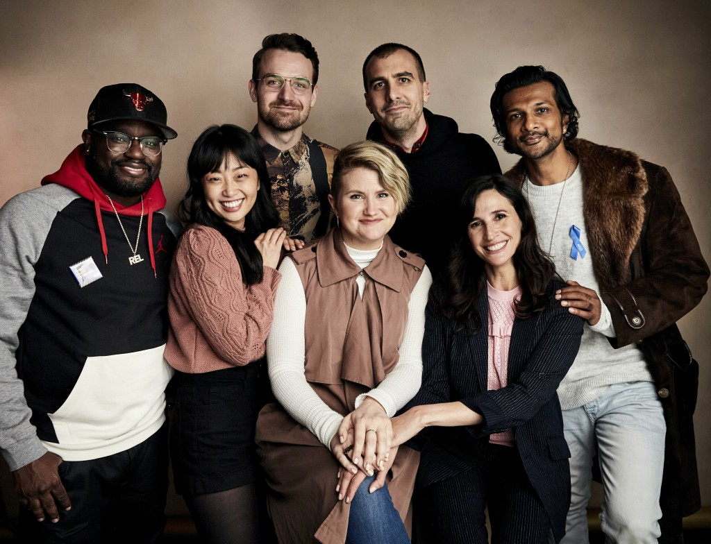 Lil Rel Howery, from left, Alice Lee, Micah Stock, Jillian Bell, director Paul Downs Colaizzo, Michaela Watkins and Utkarsh Ambudkar pose for a portra