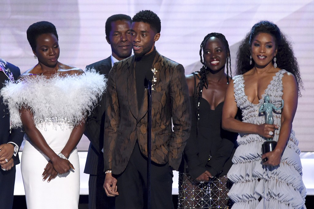 """Danai Gurira, from left, Isaach de Bankole, Chadwick Boseman, Lupita Nyong'o and Angela Bassett from the cast of """"Black Panther,"""" accept the award for"""