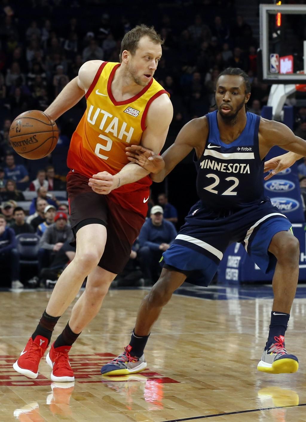 Utah Jazz's Joe Ingles, left, of Australia drives around Minnesota Timberwolves' Andrew Wiggins in the first half of an NBA basketball game Sunday, Ja...