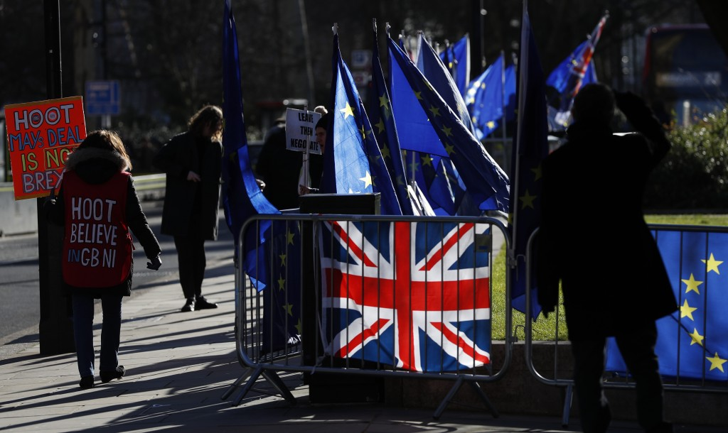 Pro and Anti Brexit protesters demonstrate outside the Houses of Parliament in London, Monday, Jan. 28, 2019. British Prime Minister Theresa May faces...