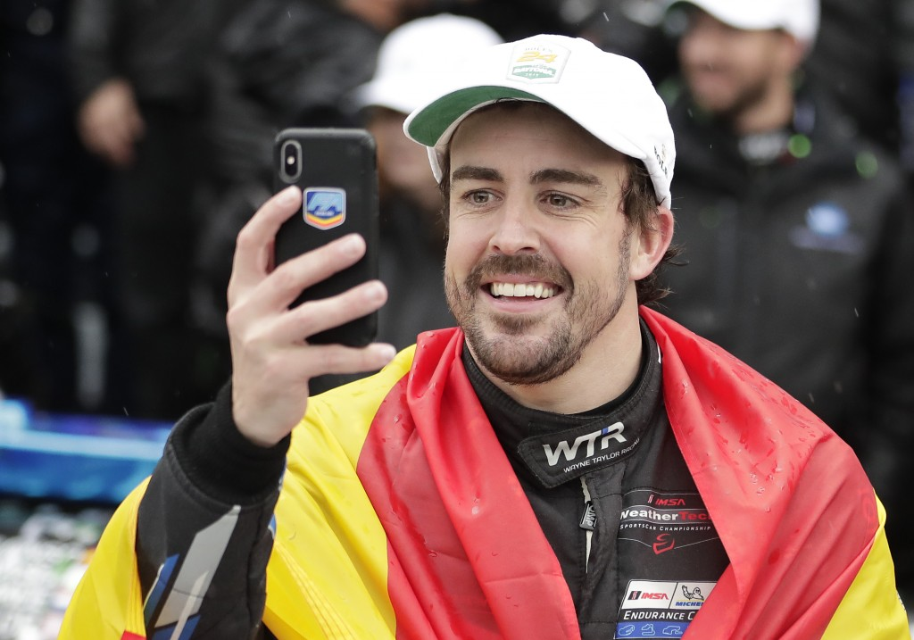 Fernando Alonso, of Spain, takes a selfie photo in Victory Lane after winning the IMSA 24 hour race at Daytona International Speedway, Sunday, Jan. 27...
