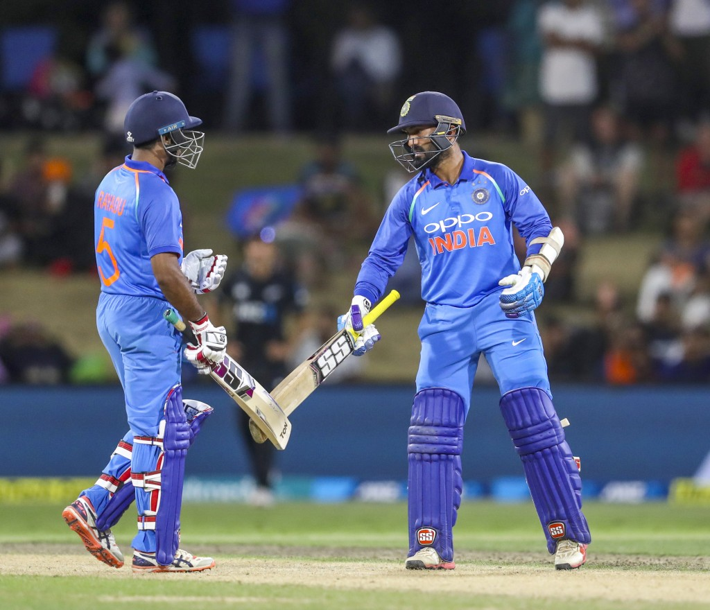India's Ambati Rayudu, left, and Dinesh Karthick celebrate at each other after their third one day international cricket match against New Zealand at ...