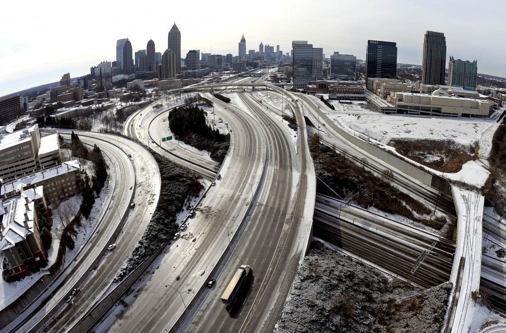 FILE - In this Jan. 29, 2014 file photo, taken with a fisheye lens looking south toward downtown Atlanta, the ice-covered interstate system shows the