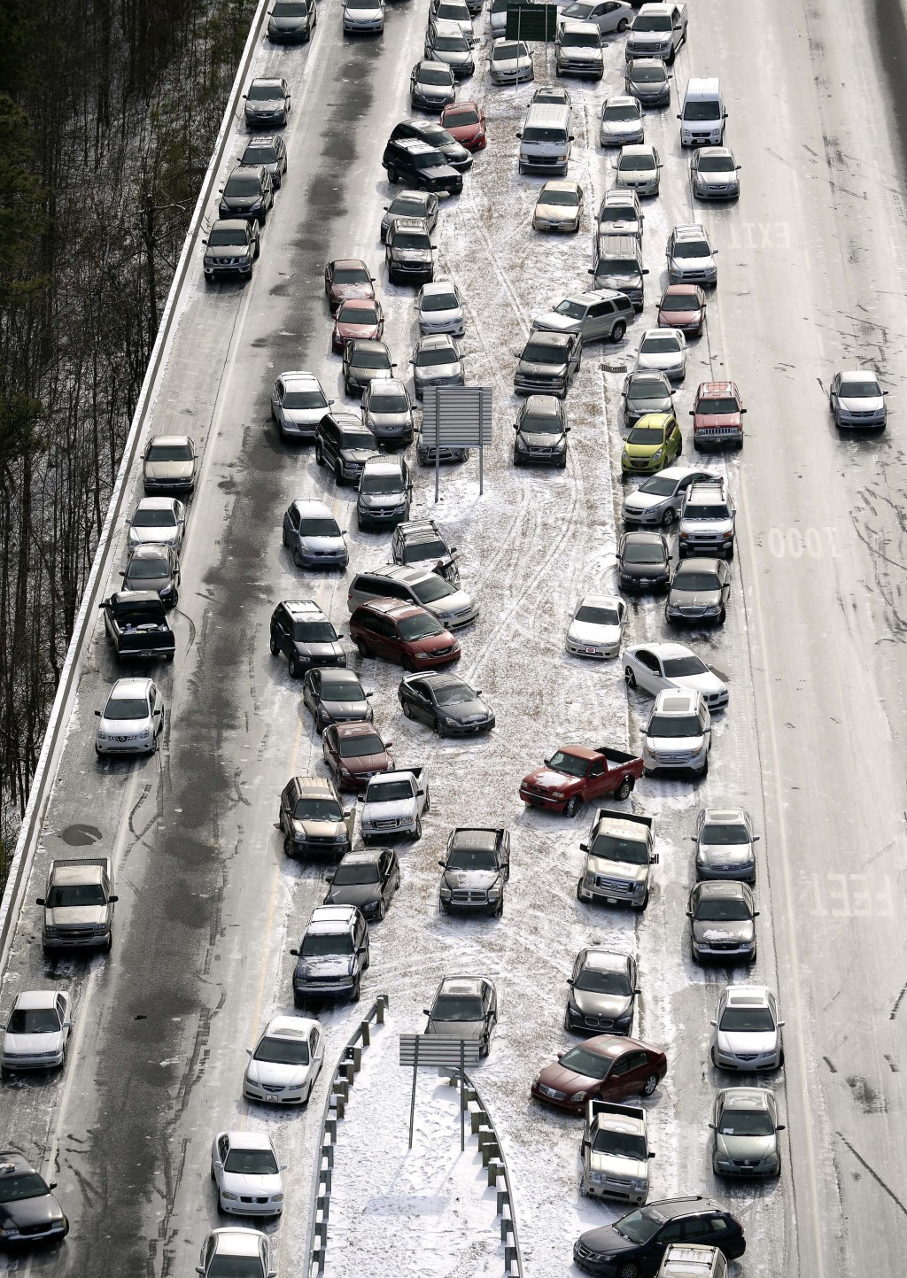 FILE-In this Jan. 29, 2014 aerial file photo, abandoned cars at I-75 headed northbound near the Chattahoochee River overpass are piled up in the media