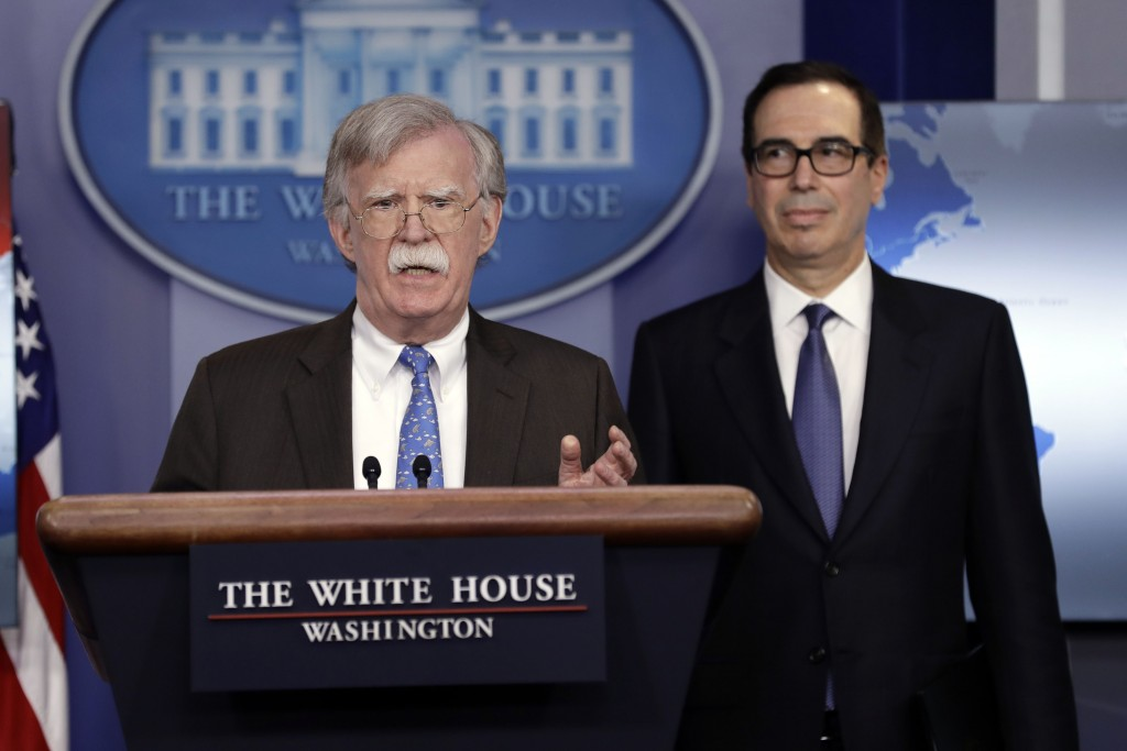 National security adviser John Bolton speaks as Treasury Secretary Steven Mnuchin listens during a press briefing at the White House, Monday, Jan. 28,...
