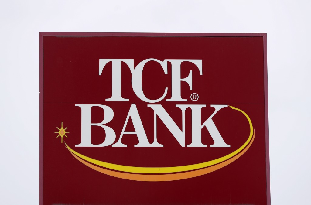 A TCF Bank sign is shown in Eastpointe, Mich., Monday, Jan. 28, 2019. Chemical Financial Corp. plans to acquire TCF Financial Corp. in an all-stock de...