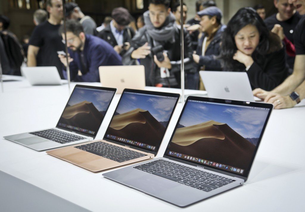 FILE- In this Oct. 30, 2018, file photo Apple's new MacBook Air computers are displayed during the company's showcase of new products in the Brooklyn ...