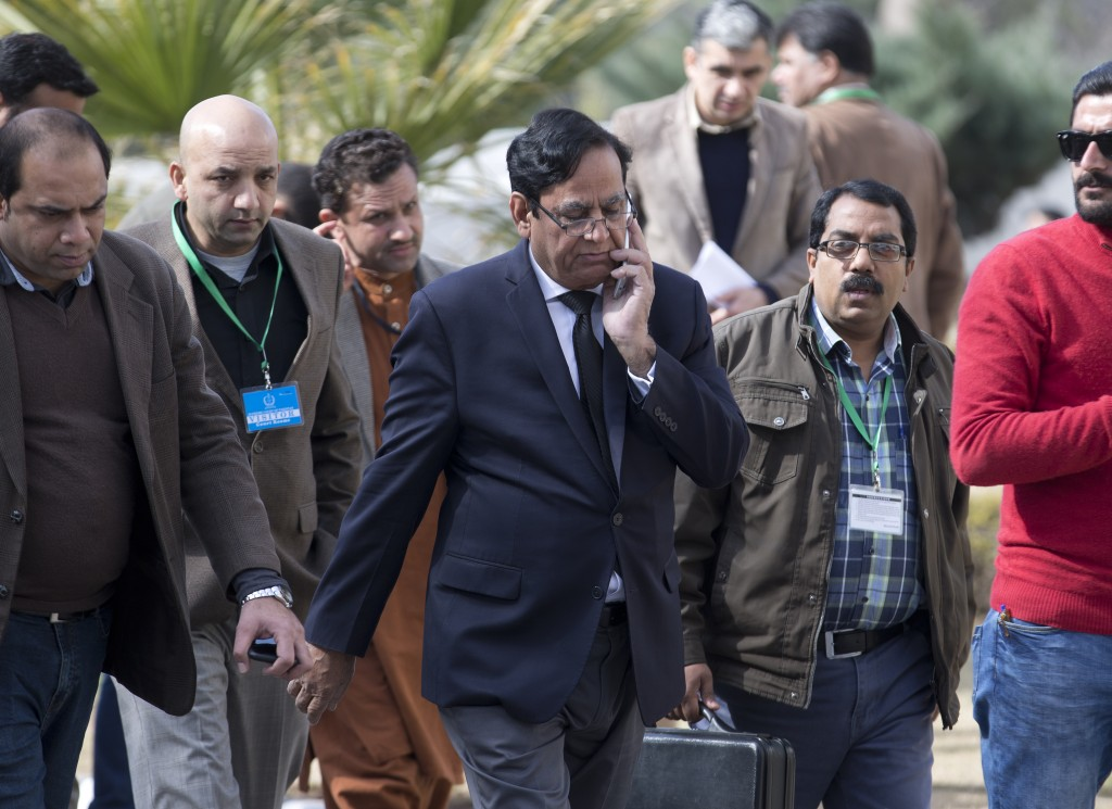 Saiful Malook, center, lawyer of Pakistani Christian woman Aasia Bibi who is facing blasphemy charges, arrives at the Supreme Court, in Islamabad, Pak