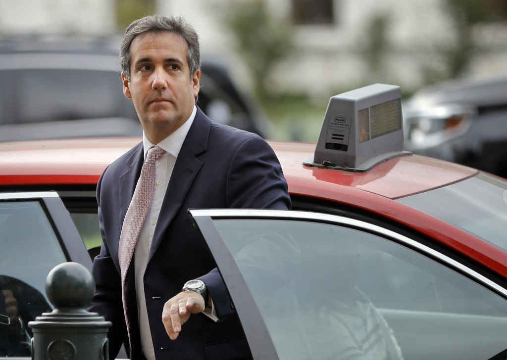 FILE - In this Sept. 19, 2017, file photo, Michael Cohen, President Donald Trump's personal attorney, steps out of a cab during his arrival on Capitol