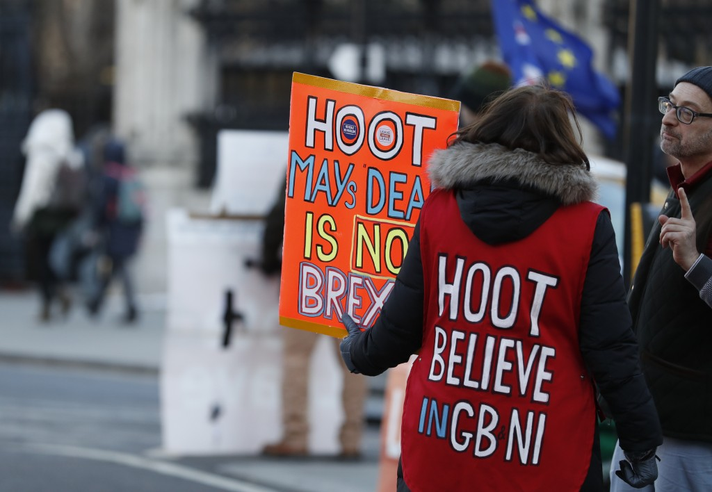 Pro Brexit demonstrators hold placards outside the Houses of Parliamnet in London, Monday, Jan. 28, 2019. Pro-Brexit British lawmakers were mounting a...
