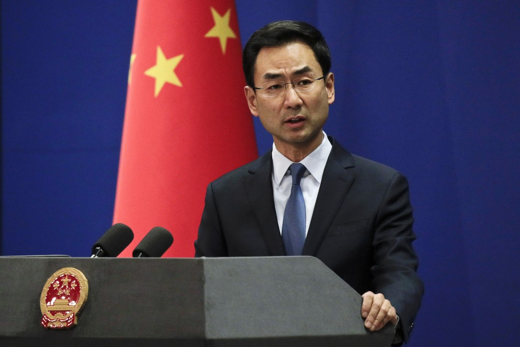 FILE - In this Tuesday, Jan. 29, 2019, file photo, Chinese Foreign Ministry spokesman Geng Shuang speaks during a daily briefing at the Ministry of Fo...