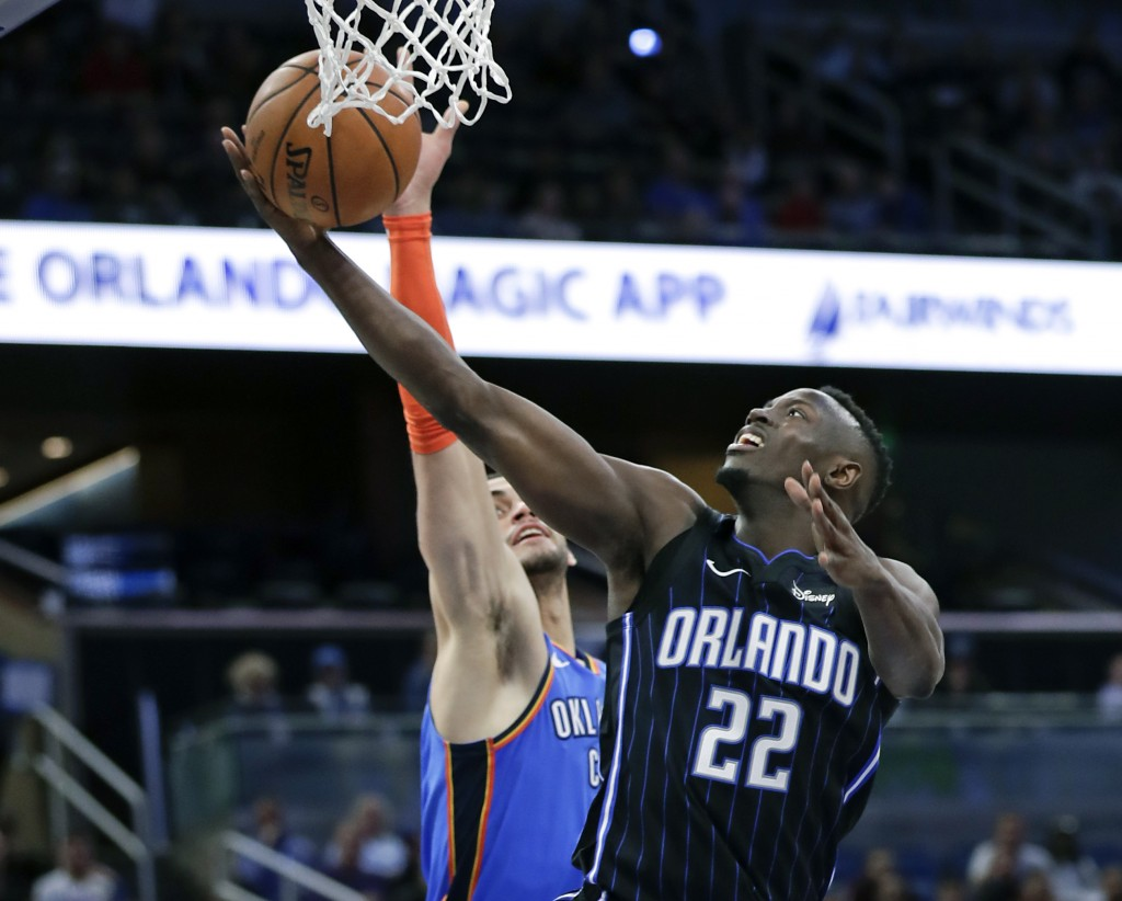 Orlando Magic's Jerian Grant (22) goes up for a shot against Oklahoma City Thunder's Abdel Nader, left, during the second half of an NBA basketball ga...