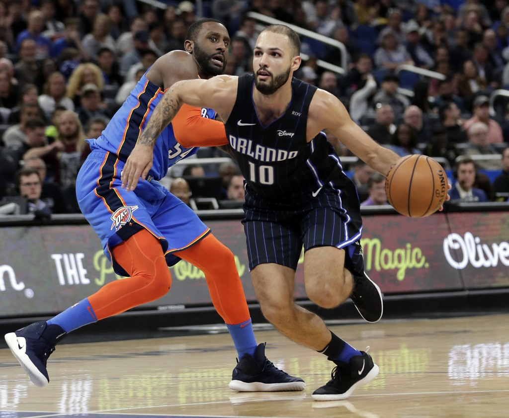 Orlando Magic's Evan Fournier (10) drives around Oklahoma City Thunder's Patrick Patterson, left, during the second half of an NBA basketball game, Tu...