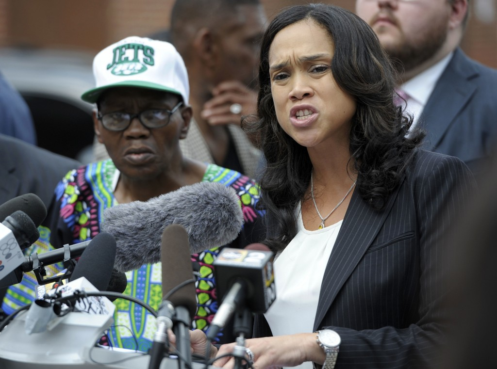 FILE - In this July 27, 2016 file photo, Baltimore State's Attorney Marilyn Mosby, right, holds a news conference near the site where Freddie Gray was...