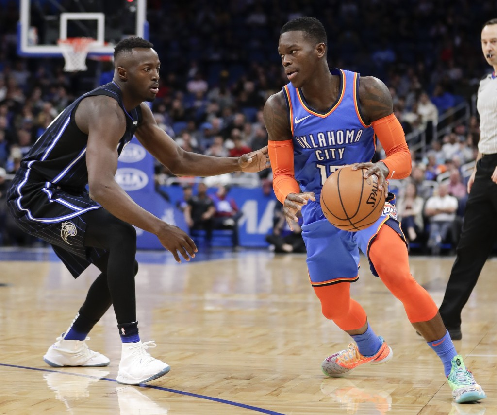Oklahoma City Thunder's Dennis Schroder, right, looks for a way past Orlando Magic's Jerian Grant during the first half of an NBA basketball game, Tue...
