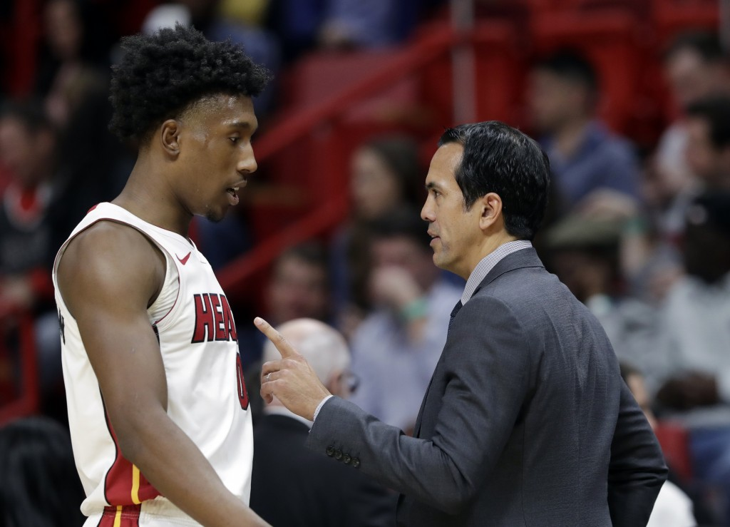 Miami Heat head coach Erik Spoelstra, right, talks with guard Josh Richardson during the first half of an NBA basketball game against the Chicago Bull...