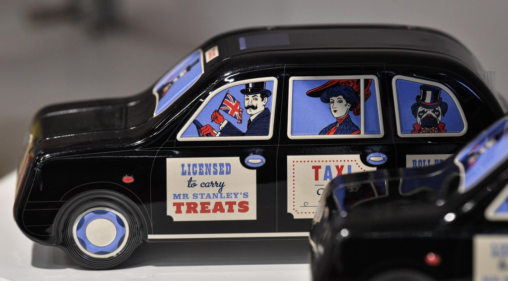 British candy maker Mr. Stanley shows his sweets boxed in an English taxicab at the international candy fair ISM in Cologne, Germany, Wednesday, Jan. ...