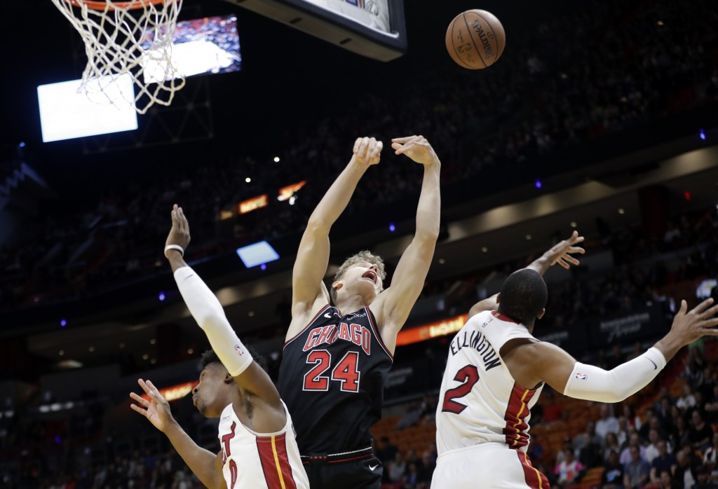 Chicago Bulls forward Lauri Markkanen (24) loses control of the ball as Miami Heat guard Josh Richardson, left, and guard Wayne Ellington (2) defend d...