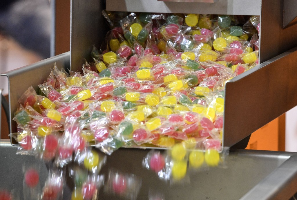 A machine produces hard candy at the international candy fair ISM in Cologne, Germany, Wednesday, Jan. 30, 2019. Approx. 5 % of German production of s...