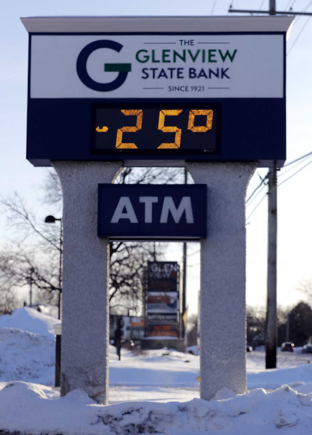 A sign shows the current outdoor temperature in Glenview, Ill., Wednesday, Jan. 30, 2019. A deadly arctic deep freeze enveloped the Midwest with recor...