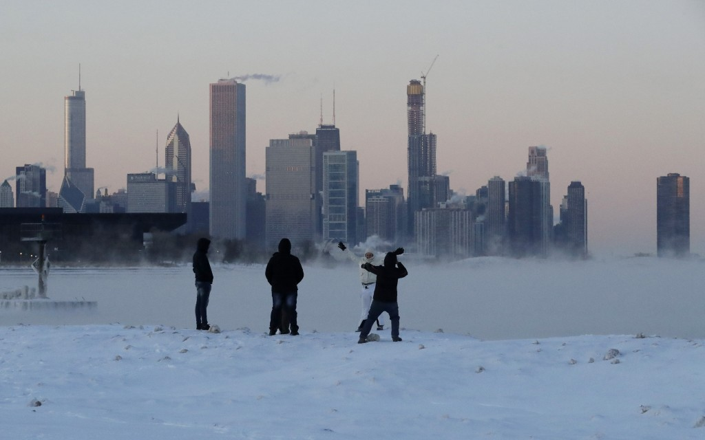 People enjoy at the Lake Michigan at 31st Street Harbor, Wednesday, Jan. 30, 2019, in Chicago. A deadly arctic deep freeze enveloped the Midwest with ...