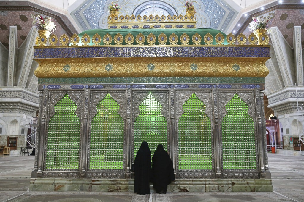 In this Saturday, Jan. 19, 2019 photo, people pray at the grave of Ayatollah Ruhollah  Khomeini at his shrine, just outside of Tehran, Iran. Khomeini ...