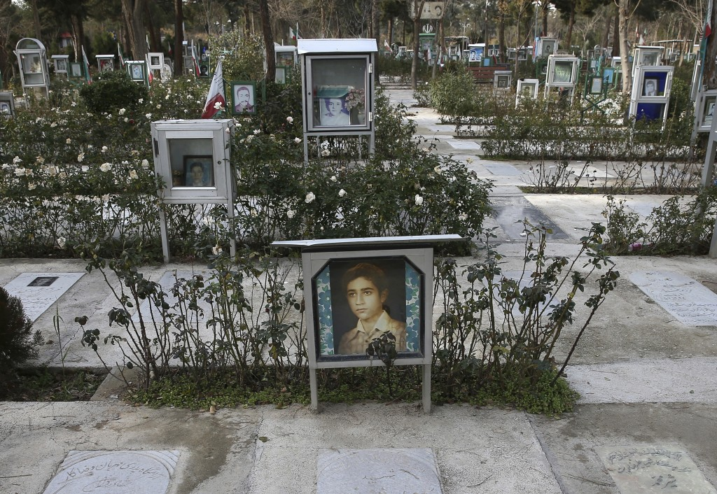 This Saturday, Jan. 19, 2019 photo, shows the graves of revolutionaries who were killed during 1979 Islamic Revolution, at Behesht-e-Zahra cemetery, j