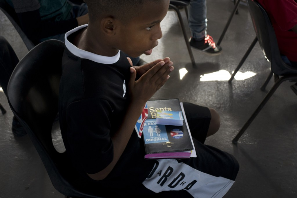 A child prays during bible school at an evangelical church in Havana, Cuba, Sunday, Jan. 27, 2019. The long process of reforming Cuba's constitution b...