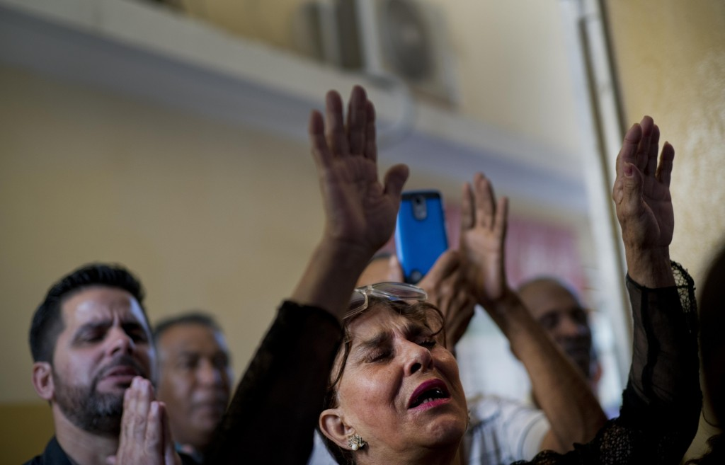 Evangelicals pray during a Mass at a church in Havana, Cuba, Sunday, Jan. 27, 2019. A Cuban government push to legalize gay marriage has set off an un...