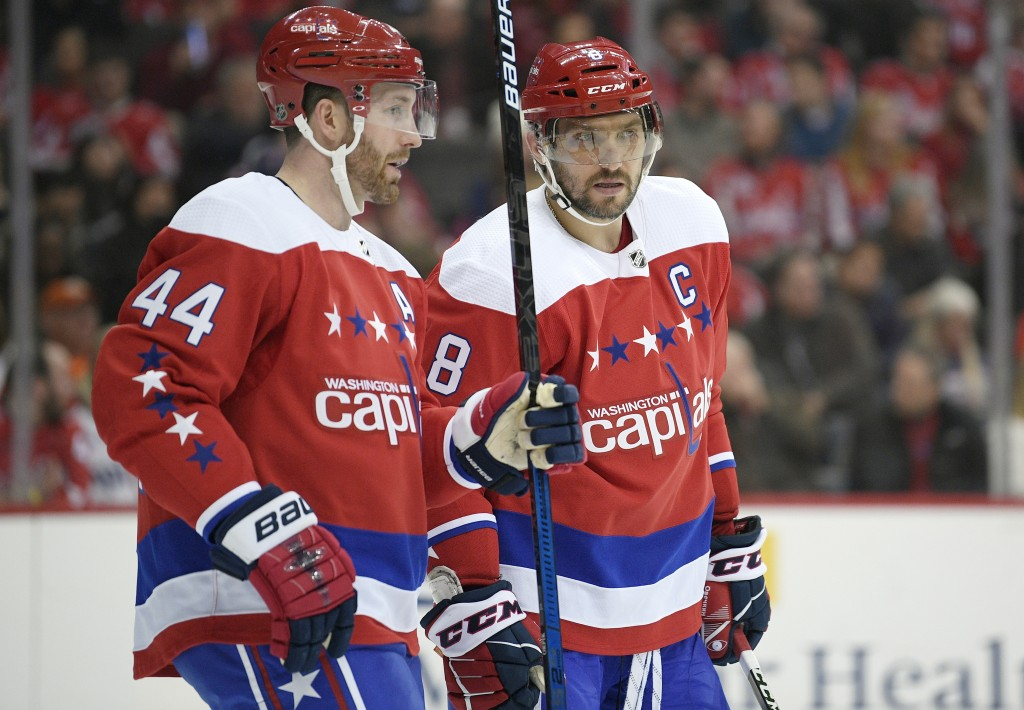 FILE - In this Jan. 18, 2019, file photo, Washington Capitals left wing Alex Ovechkin (8), of Russia, talks with defenseman Brooks Orpik (44) during t