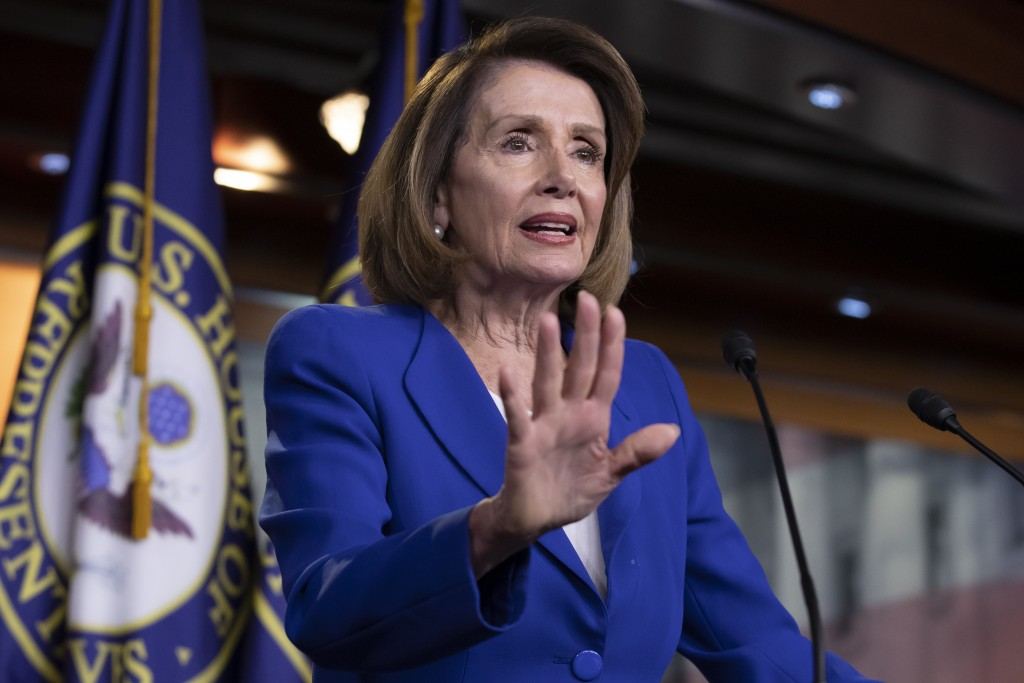 Speaker of the House Nancy Pelosi, D-Calif., talks to reporters during a news conference a day after a bipartisan group of House and Senate bargainers...