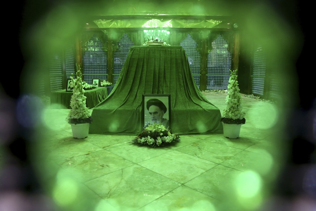 In this Saturday, Jan. 19, 2019 photo, a portrait of Ayatollah Ruhollah Khomeini is displayed at his grave, just outside of Tehran, Iran. Khomeini was