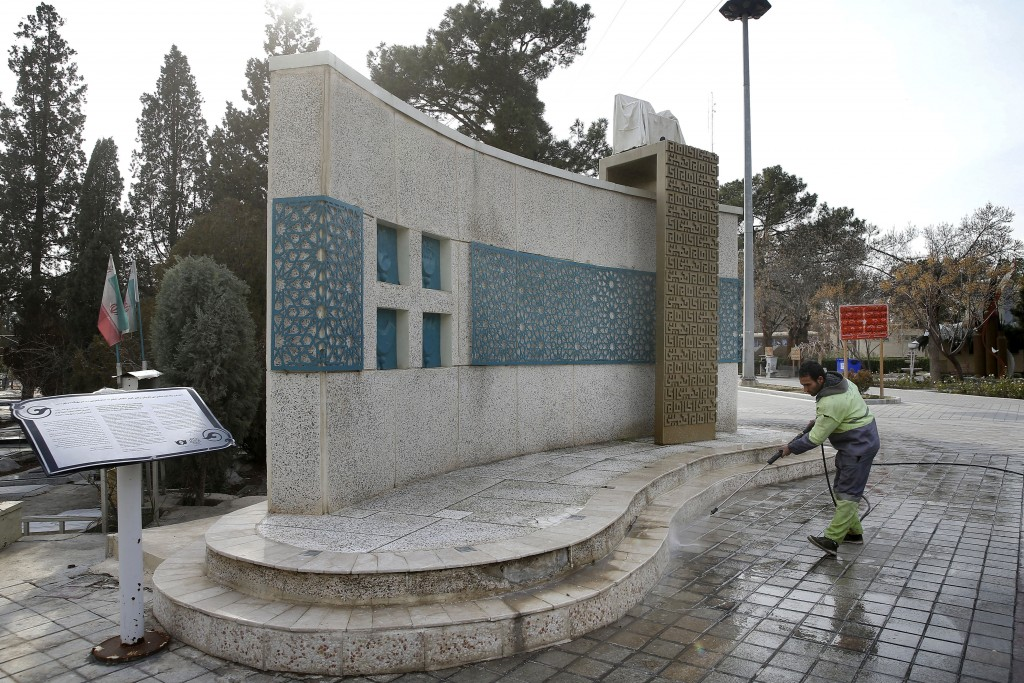 In this Saturday, Jan. 19, 2019 photo, a worker cleans a monument at the place Ayatollah Khomeini gave a speech on his return from 15 years of exile,
