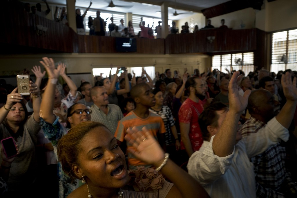 Evangelicals pray during a Mass at a church in Havana, Cuba, Sunday, Jan. 27, 2019. The number of evangelical and non-evangelical protestants is estim...