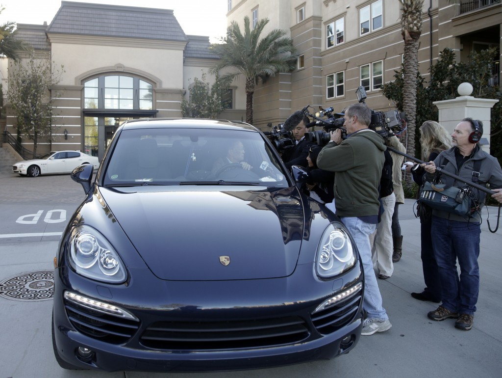 FILE - In this March 3, 2015 file photo, resident Jin-Jou Lu sits in his vehicle while talking to reporters outside after federal agents raided an ups...