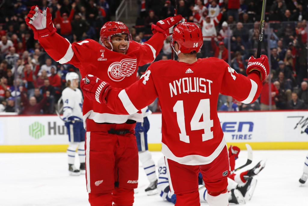 Detroit Red Wings right wing Gustav Nyquist (14) celebrates his goal with Andreas Athanasiou in the second period of an NHL hockey game against the To...