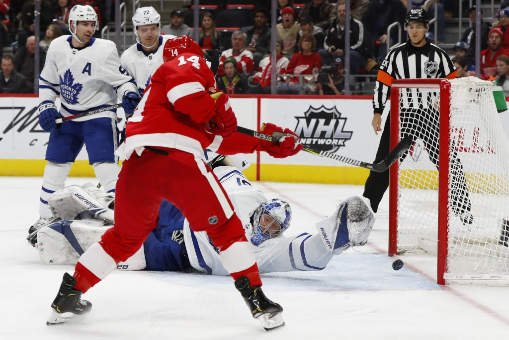 Detroit Red Wings right wing Gustav Nyquist (14) scores on Toronto Maple Leafs goaltender Frederik Andersen (31) in the second period of an NHL hockey...