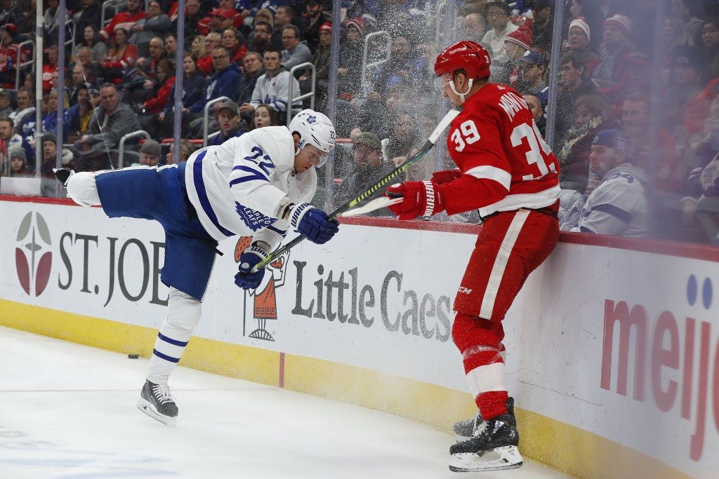 Toronto Maple Leafs defenseman Nikita Zaitsev (22) misses a check on Detroit Red Wings right wing Anthony Mantha (39) in the second period of an NHL h