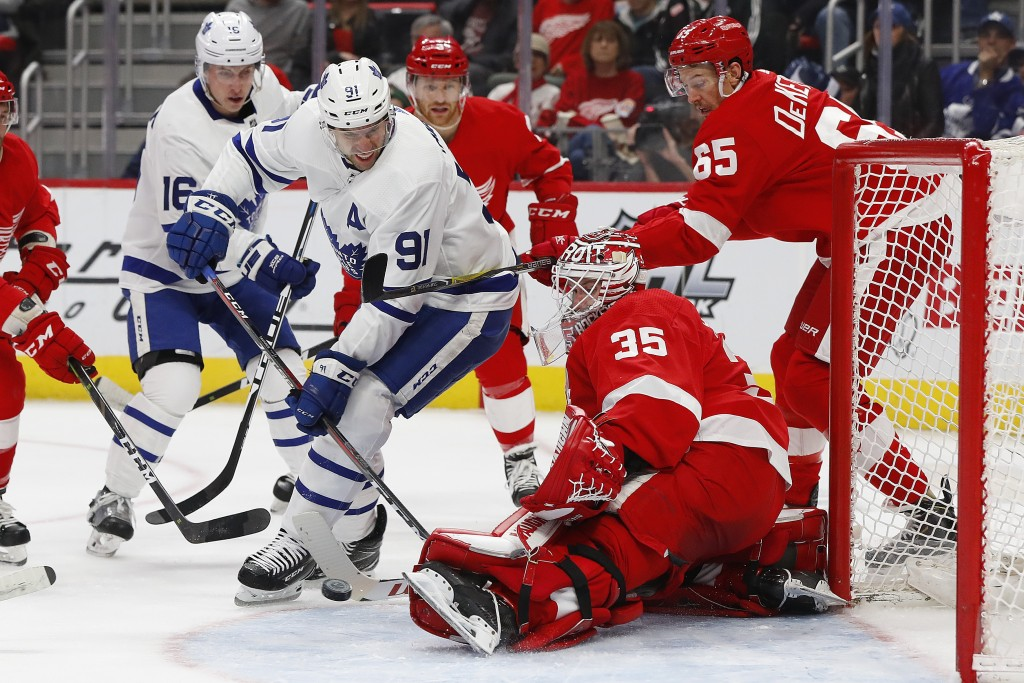 Detroit Red Wings goaltender Jimmy Howard (35) stops a shot by Toronto Maple Leafs center John Tavares (91) in the first period of an NHL hockey game,...